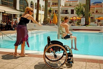 Family using pool hoist in accessible hotel in Tenerife