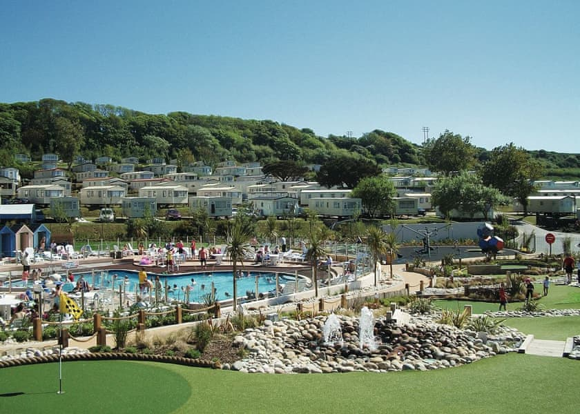 Pool and caravans at accessible disabled holiday park on the Dorset coast