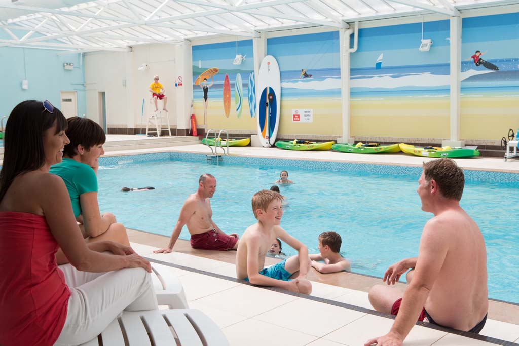 Family enjoying the swimming pool at an accessible holiday park in Cornwall