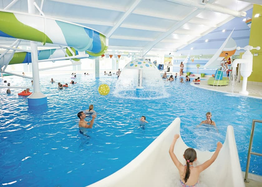 Indoor swimming pool and waterslide at accessible Somerset holiday park