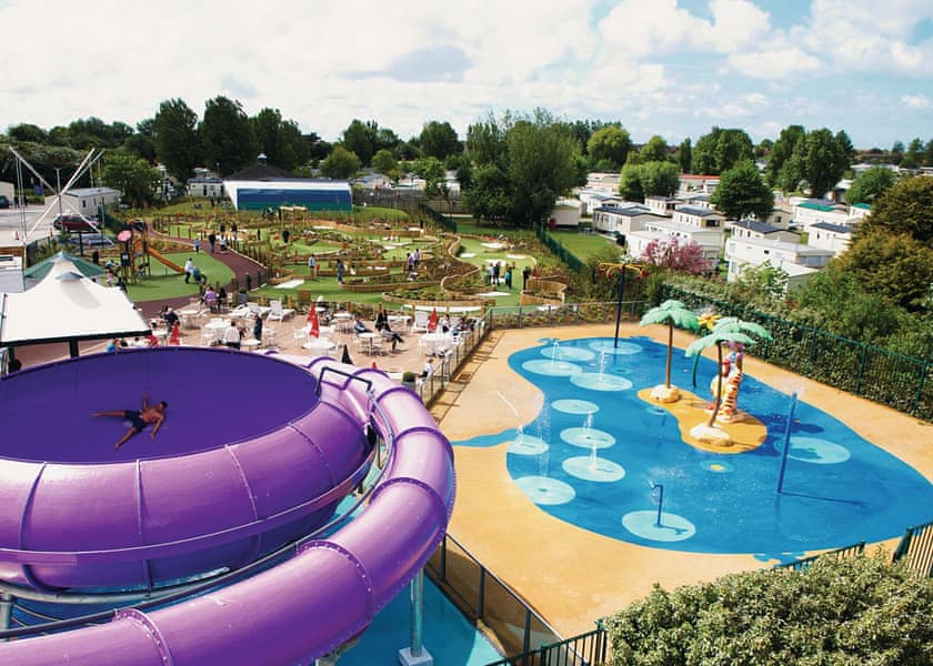 Swimming pool and rides at accessible holiday park in Lancashire