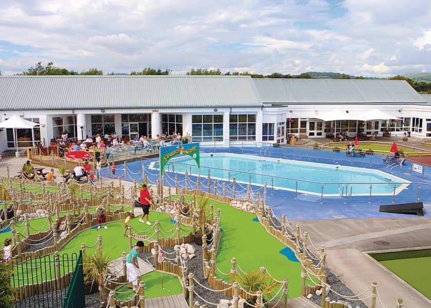 Mini golf and outdoor swimming pool at an accessible holiday park in the Lake District