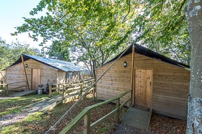 Accessible glamping lodges with pool hoists in Newton Abbot, Devon