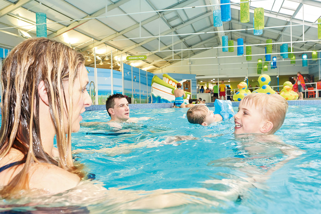 Mother and child enjoying indoor swimming pool at Yorkshire holiday park