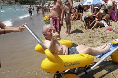 Holidaymaker using beach wheelchair in Benidorm