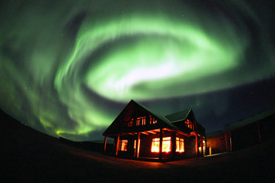 The Northern Lights above an accessible hotel in Hella, Iceland
