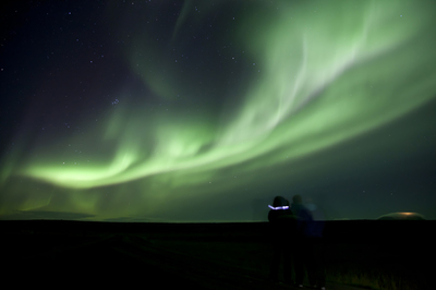 Green Northern Lights in the night sky in Iceland