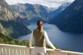 Tourist admiring the Norwegian Fjords