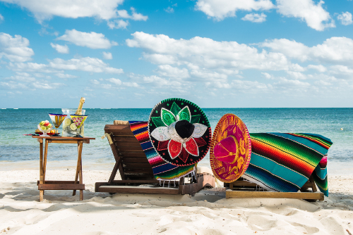 Mexican hats on sun loungers on stunning beach