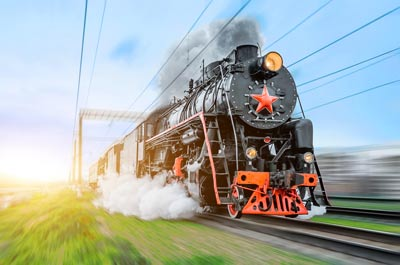 Black steam train in motion