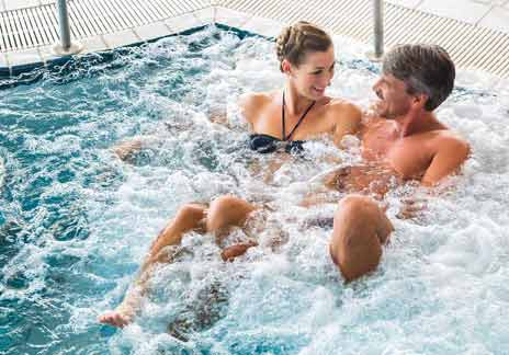 Couple relaxing in a thermal spa