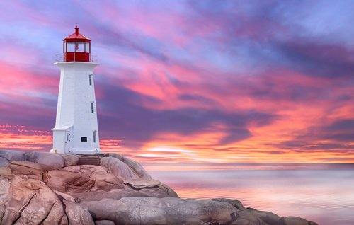 Peggy's Cove lighthouse in front of a pink sky, Canada