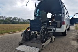 Adapted taxi van and wheelchair for travel in Barbados