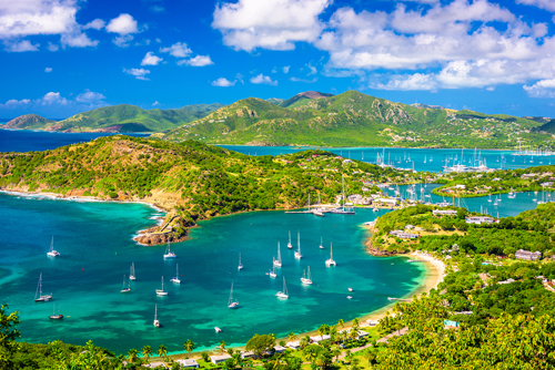 Blue waters and boats in a bay in Antigua, Caribbean