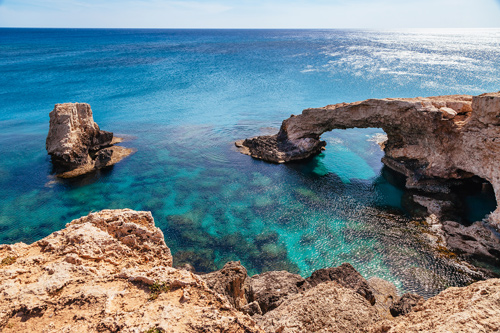 Rock arch in blue sea near Ayia Napa, Cyprus