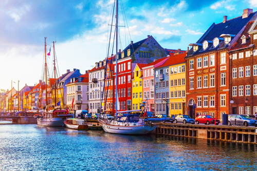 Boats and colourful buildings at Nyhavn pier, Copenahgen