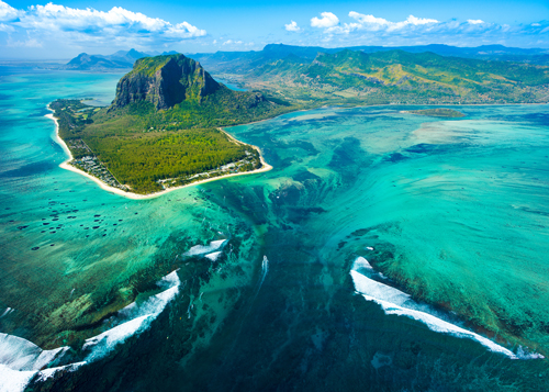 Aerial view of the green island of Mauritius, blue seas and coral reefs, Indian Ocean