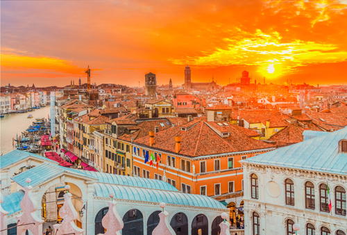 Sunset over the roofs and canals of Venice, Italy