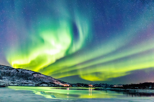 Northern Lights over a frozen lake in Norway