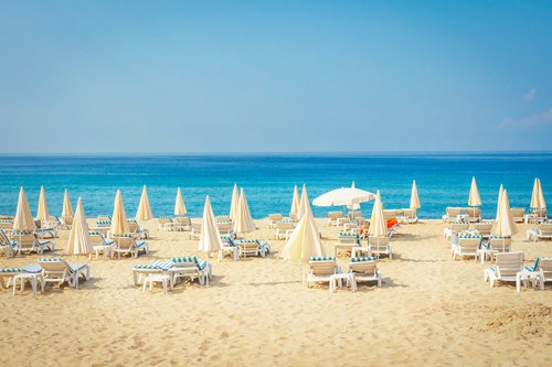 Deck chairs and umbrellas on a beautiful beach in Alanya, Antalya, Turkey