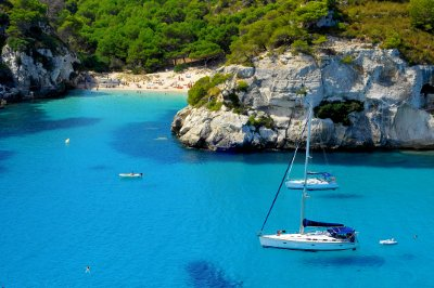 Boats near a sunny beach in the Balearics