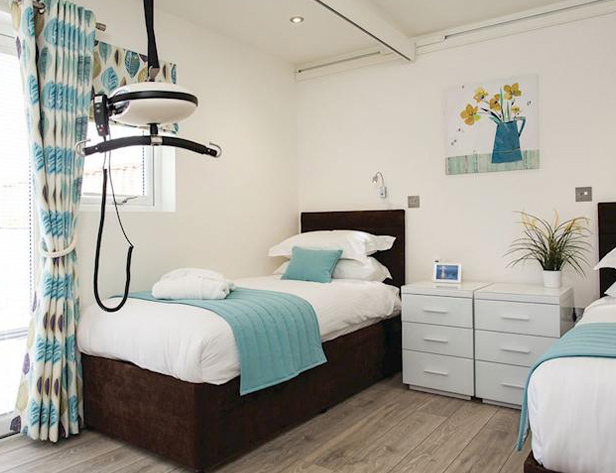 Ceiling track hoist in a disabled-friendly bedroom
