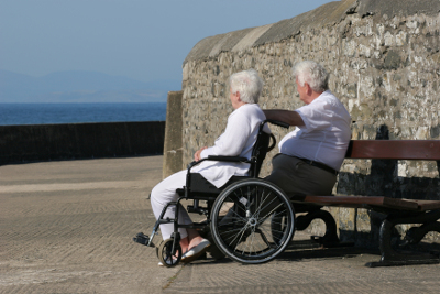 Elderly people looking out to sea
