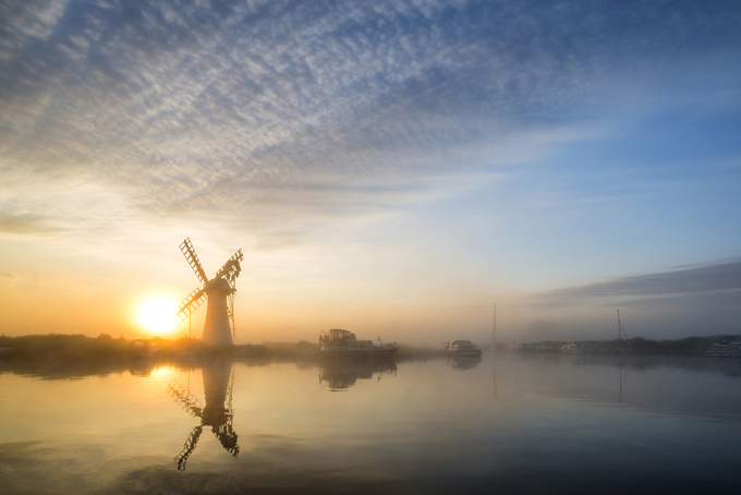 Windmill on the Norfolk Broads at sunset