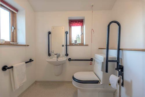 Accessible bathroom with Closomat shower toilet in Herefordshire