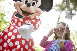 Girl and Minnie Mouse at Disney theme park