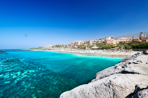Sunny beach and clear blue sea in Tenerife