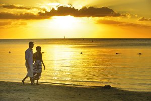 Couple walking on the beach in Mauritius